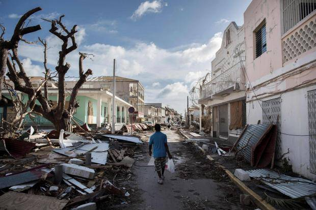 """Photo_ The Independent, """"Hurricane Irma_ A week on from the deadly storm and St Martin residents are struggling to survive"""", Getty Images"""